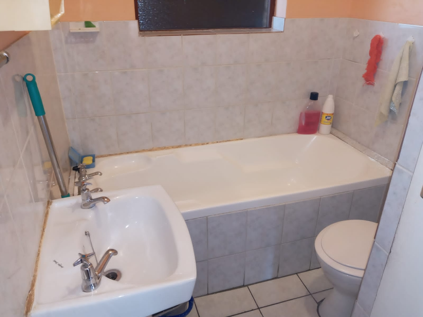 Bathroom with bath, wash basin, toilet and shower on right