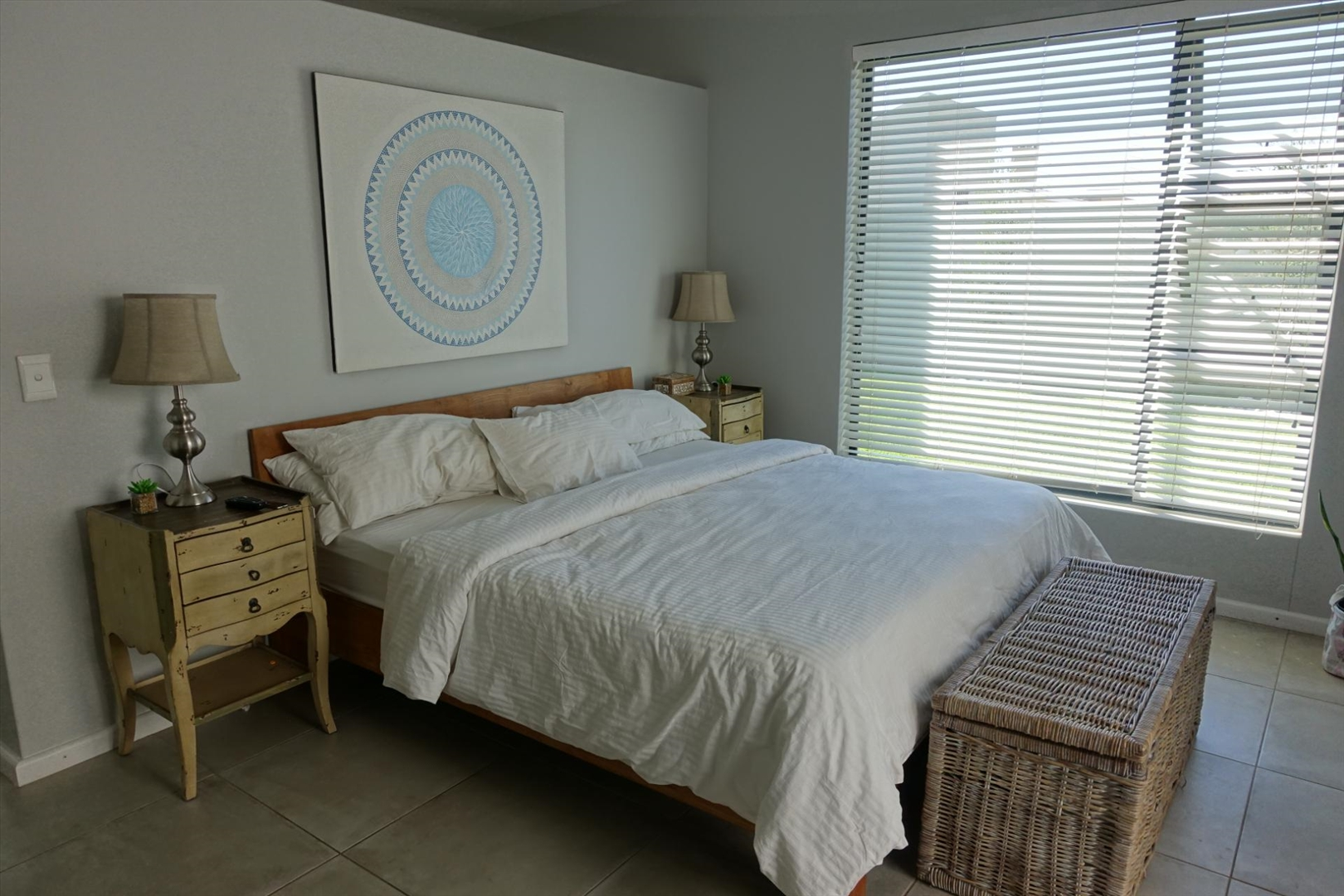 Main bedroom with sliding doors opening onto the patio
