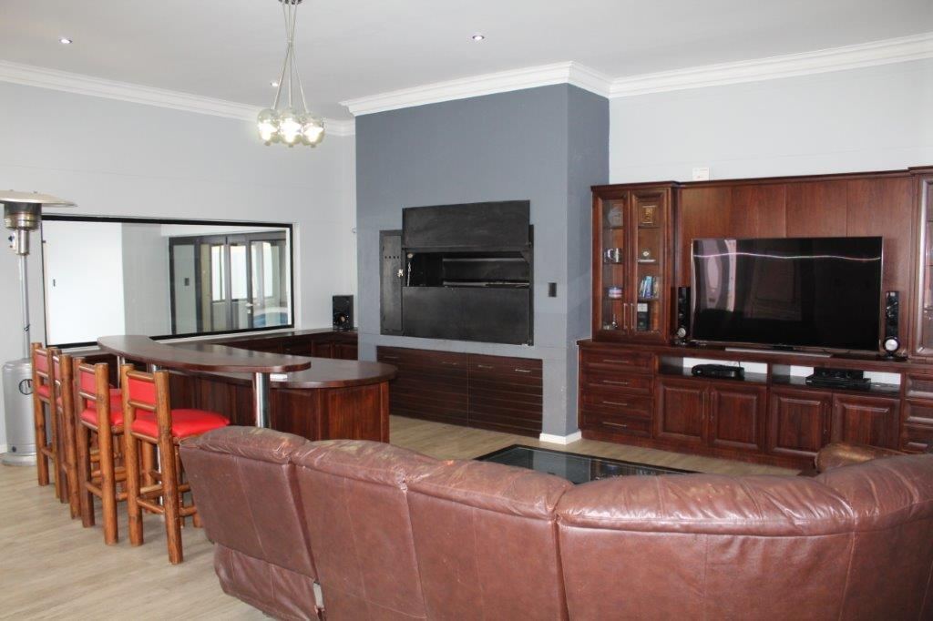 Entertainment area - opening onto a stoep with outdoor BBQ