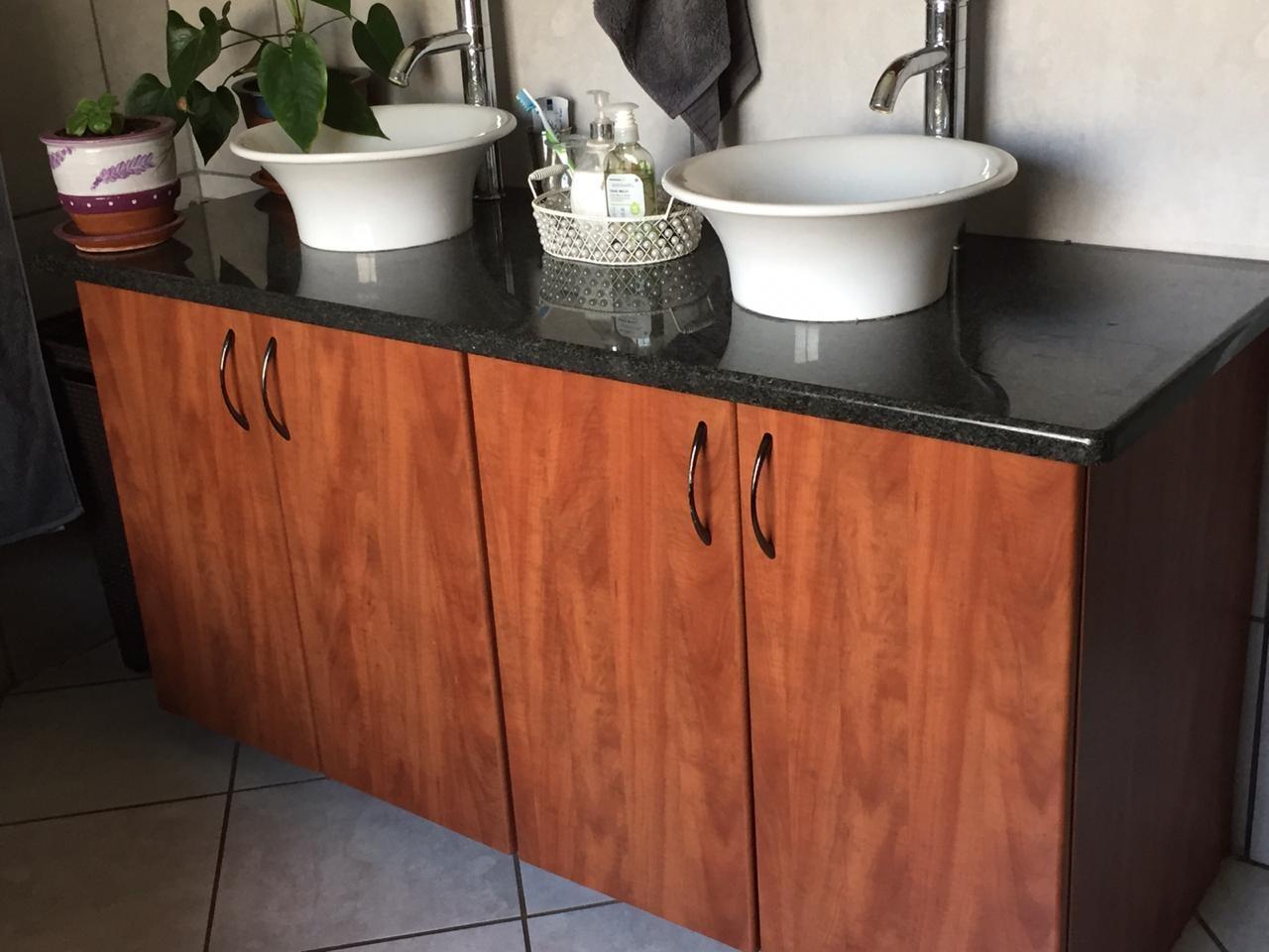 Beautiful fitted cupboards in en-suite bathroom