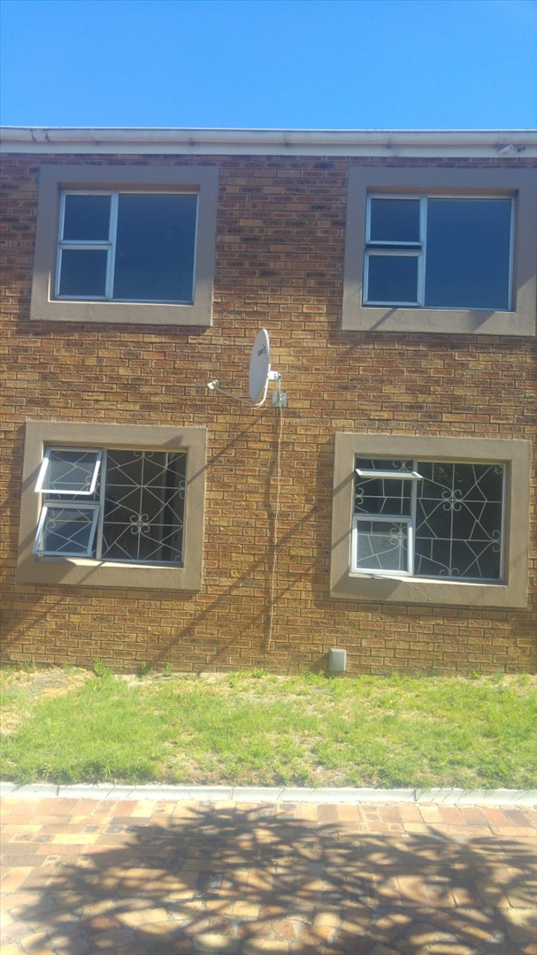 Side view of apartment showing windows with burglar bars