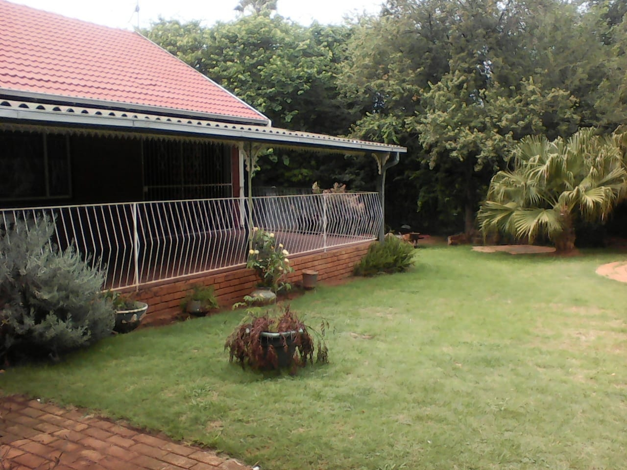 Large veranda overlooking back garden and pool
