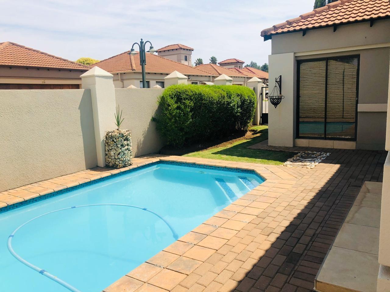 Private swimming pool in garden