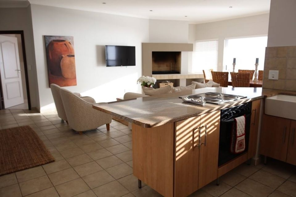 Open plan kitchen, tv are and dining room