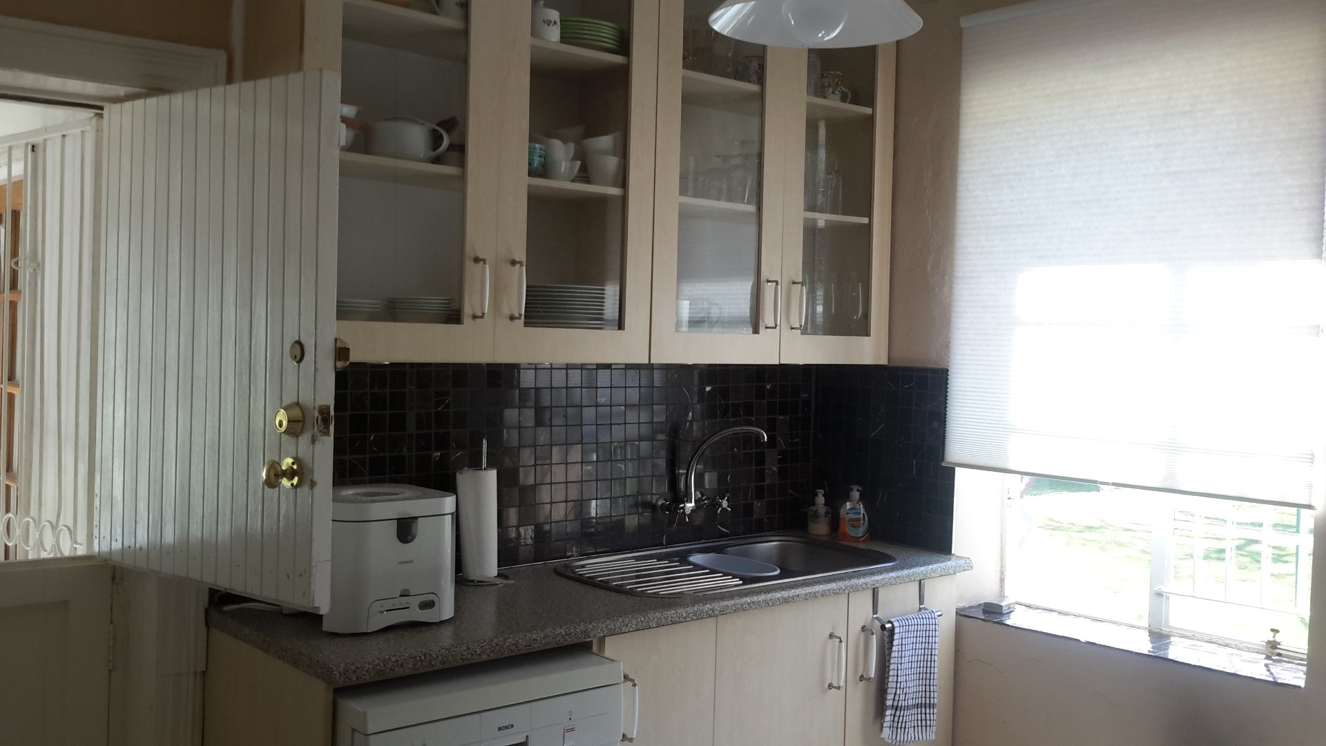 Kitchen with very modern fitted cupboards