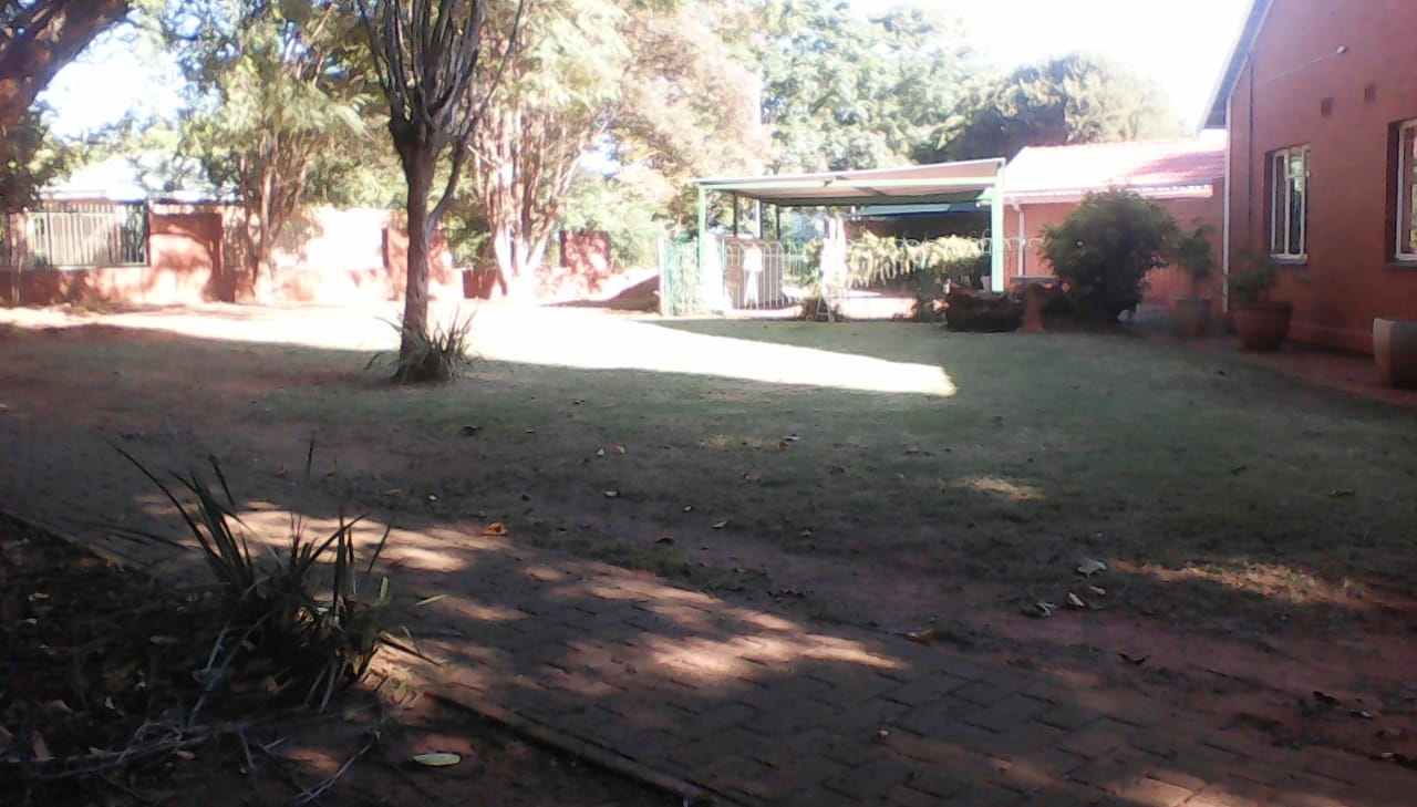 Side view of garden towards street
