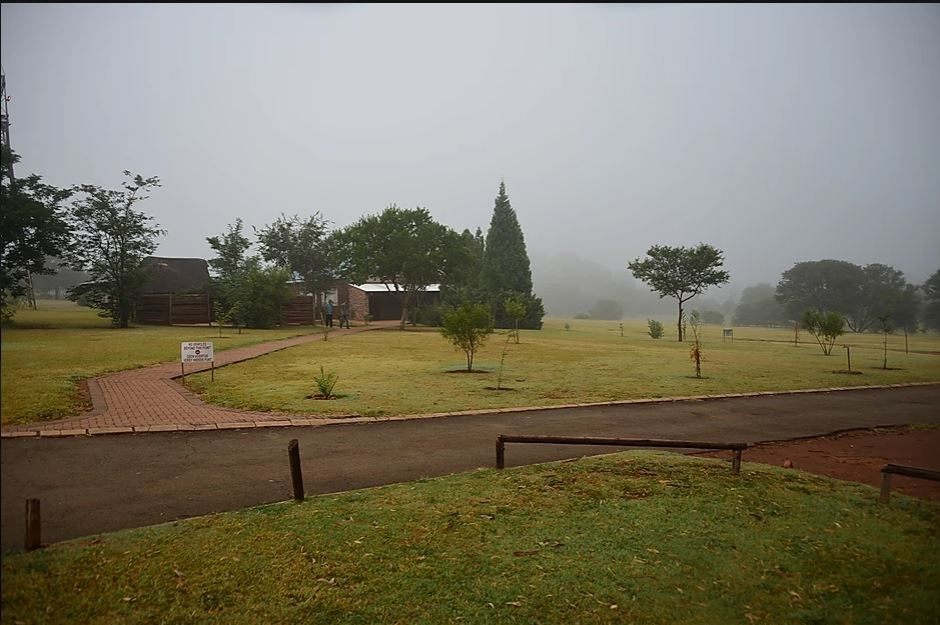 View inside the road on a misty day. Notice the tarred roads