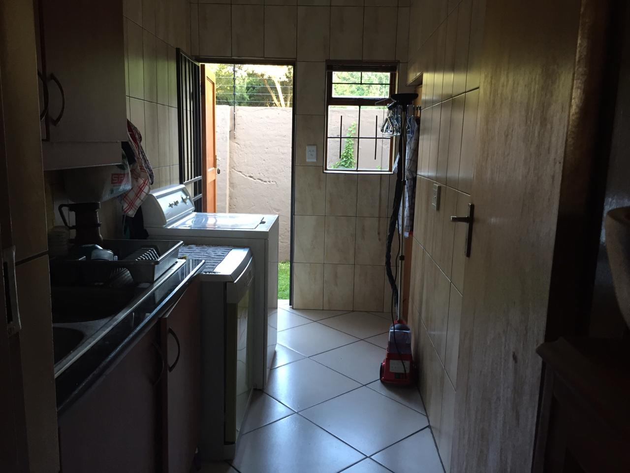 Scullery for washing opens to outside washing line
