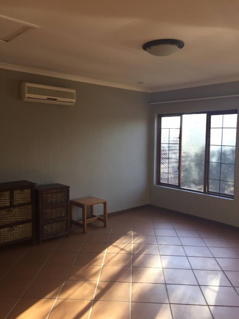 Living area in flat showing air-conditioner