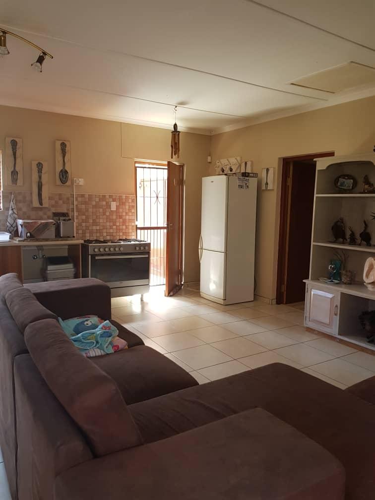 Open plan kitchen, tv area in flat