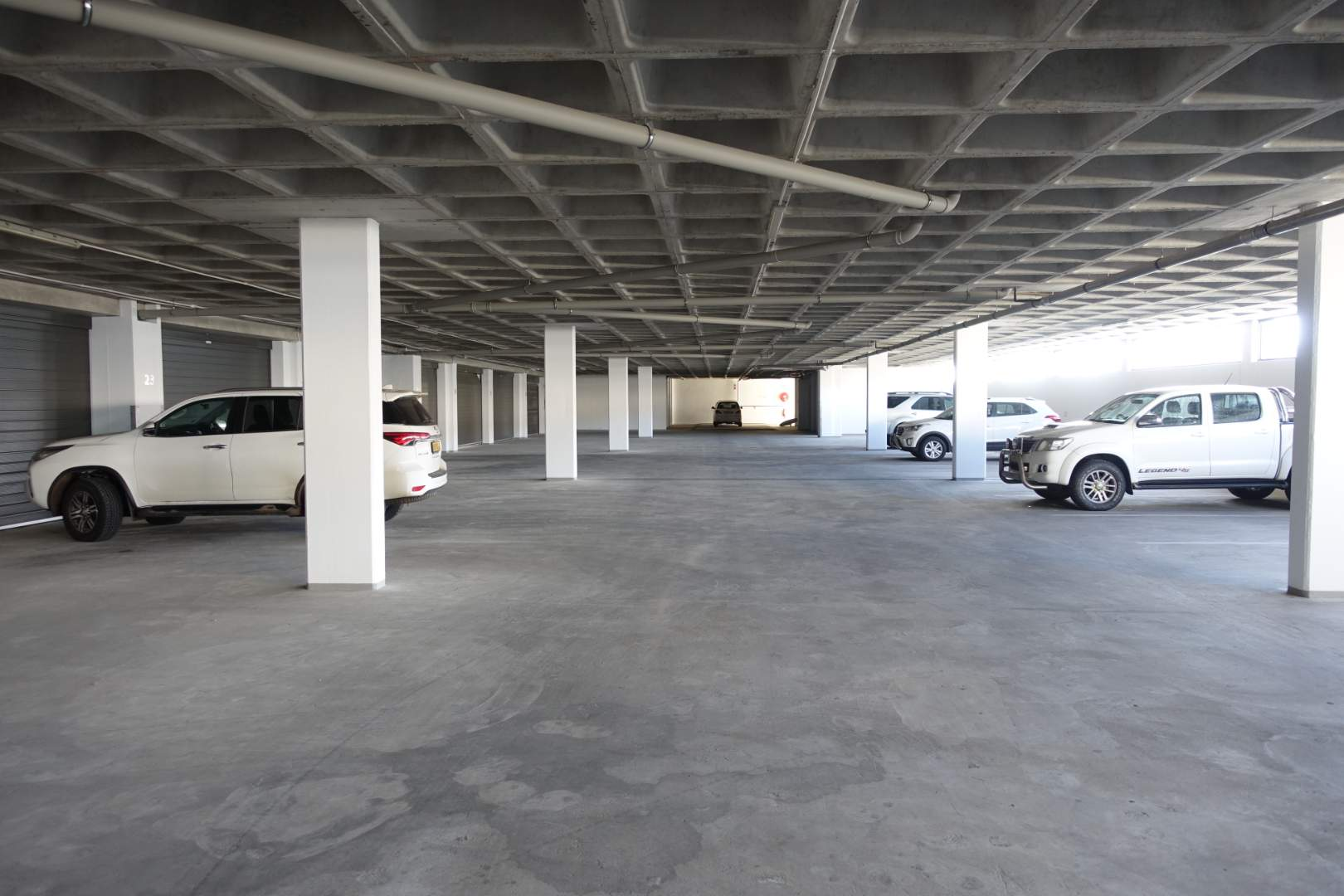 Parking bays, garages and store rooms on first floor
