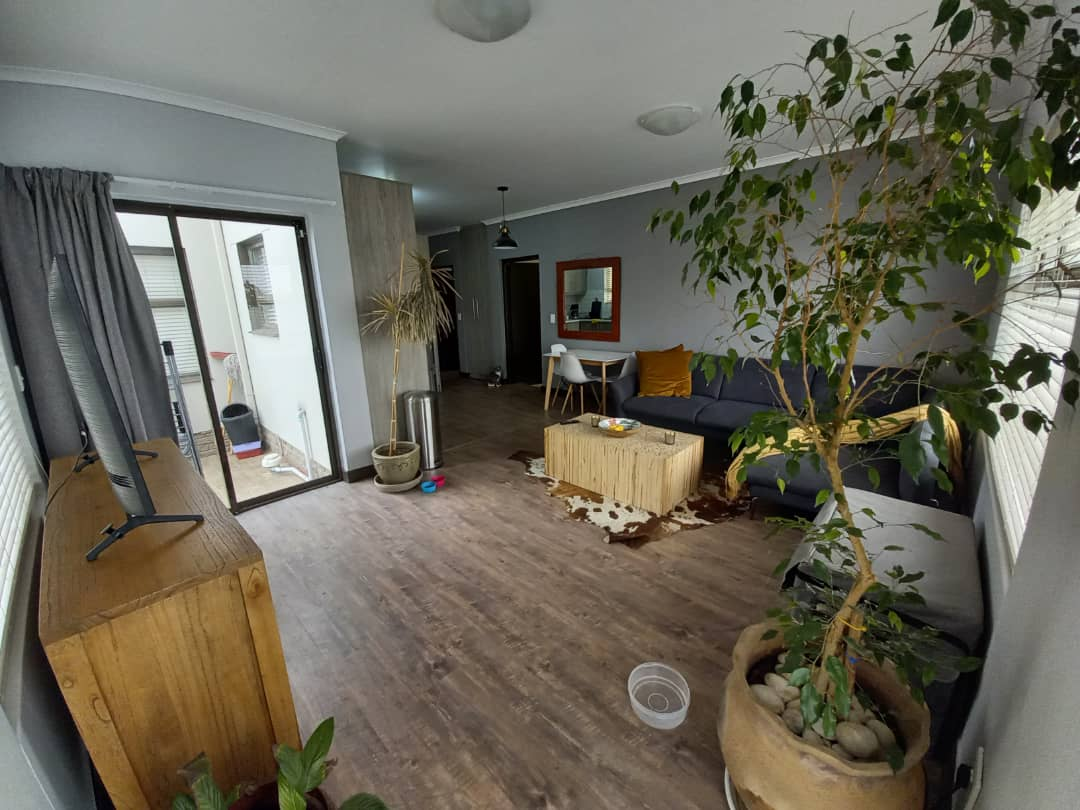 Spacious open area - tv area and kitchen