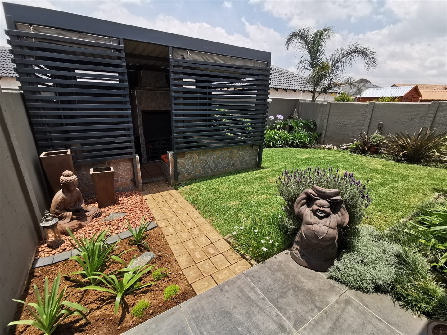 View of private and pet-friendly, landscaped garden with covered entertainment area