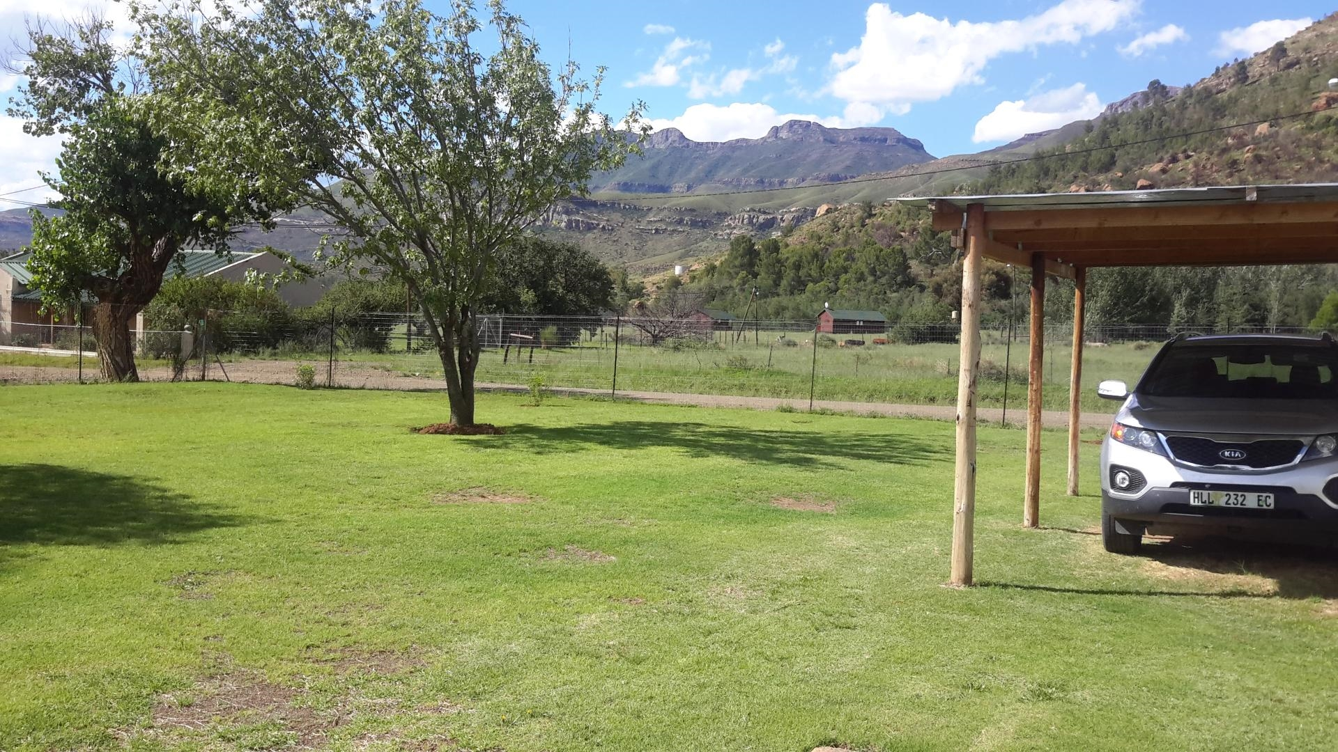 Carport outside with the magnificent view of the mountains in the background