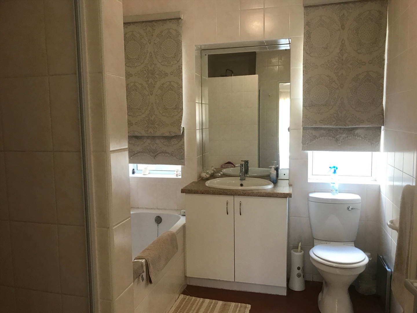 On suit bathroom with bath and shower