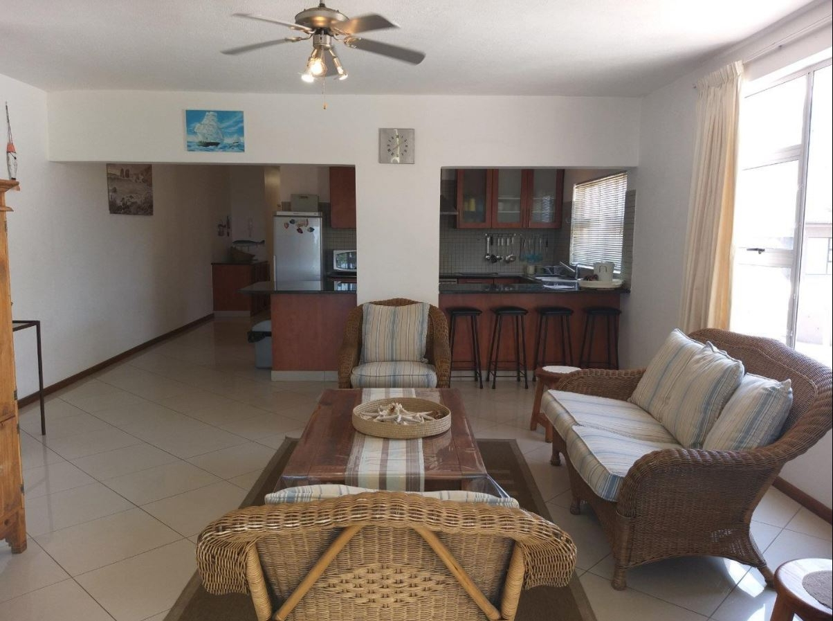 View of living area with kitchen in the background