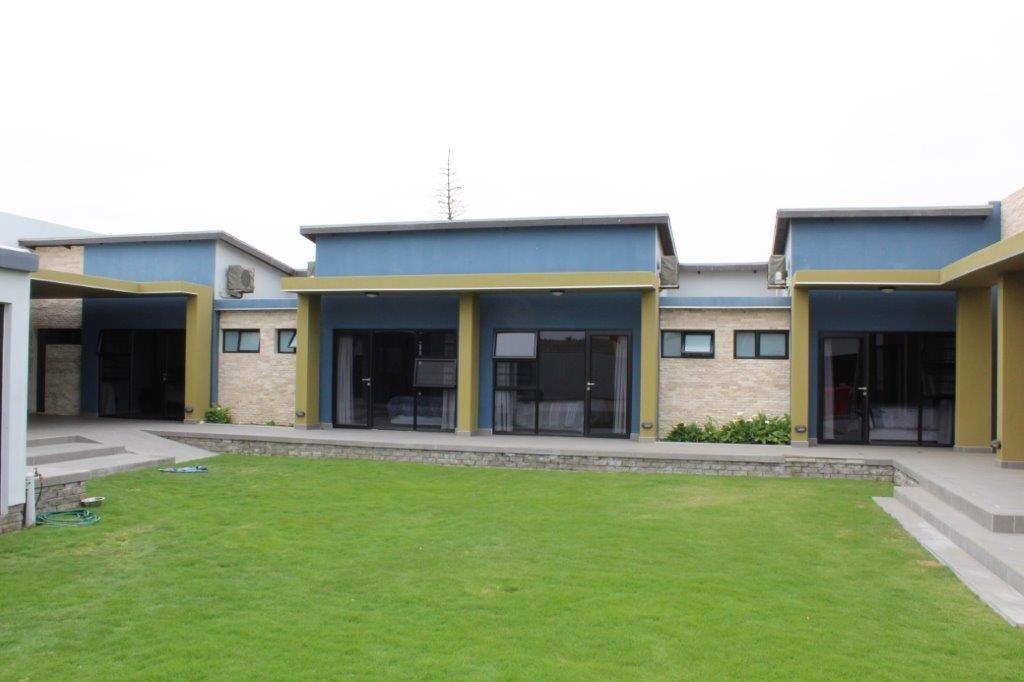 All rooms open onto an enclosed garden area.