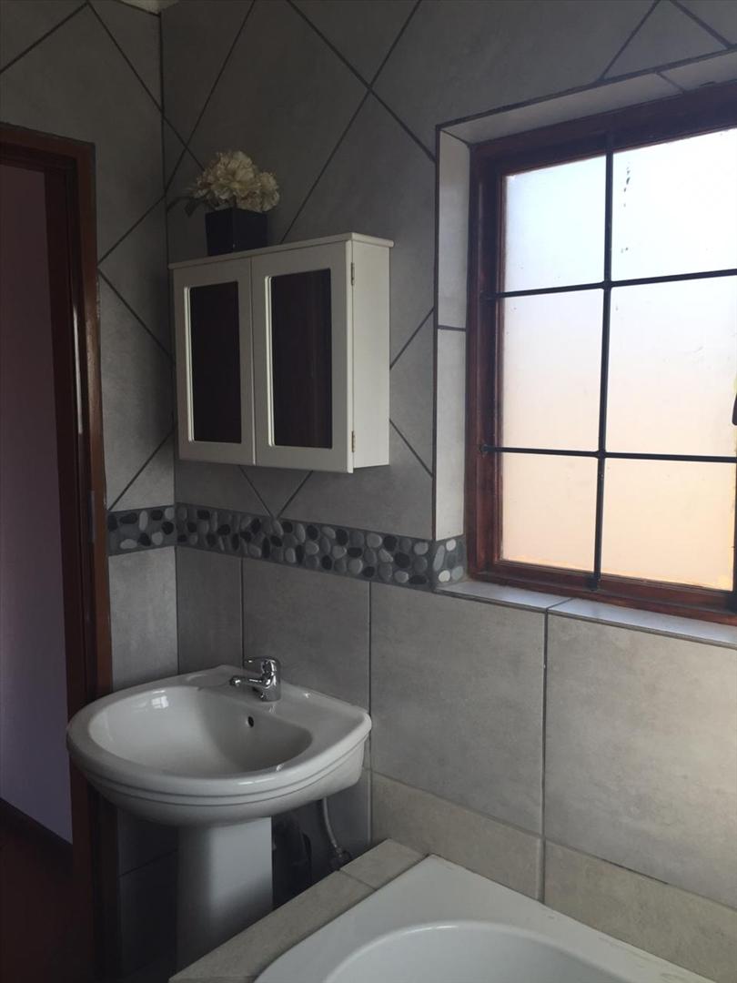 Bathroom in flat with wash basin and bath
