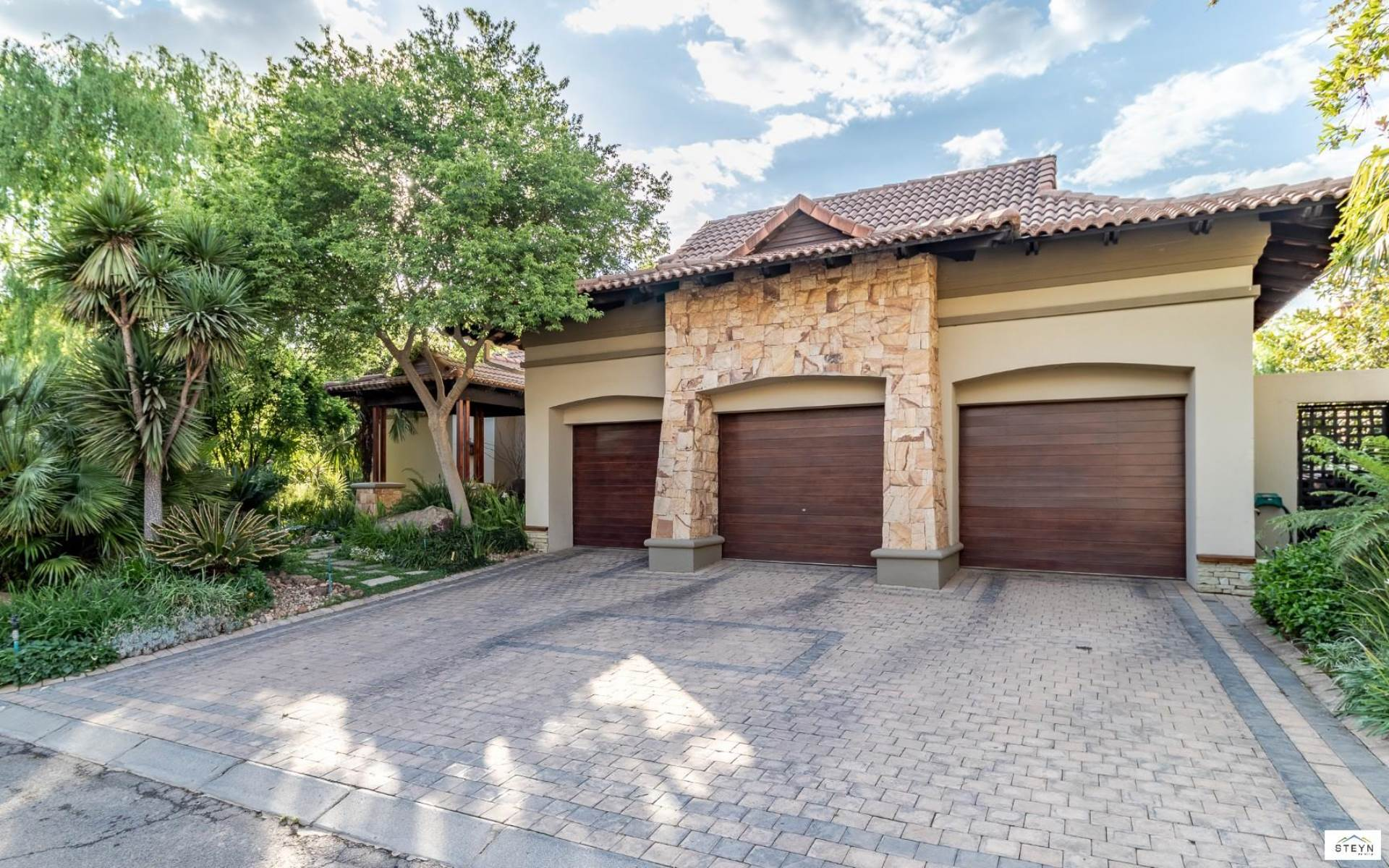 3 Garages and ample parking