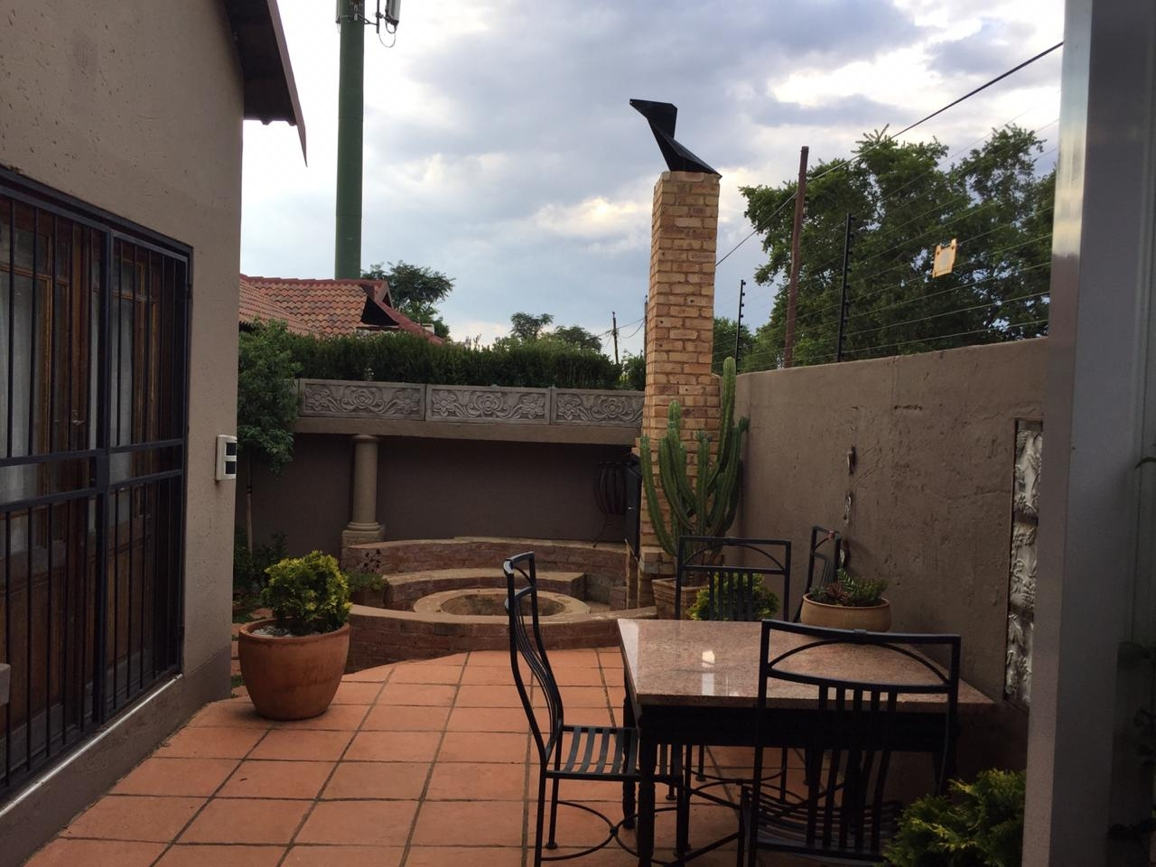 View from patio towards fire pit and braai area