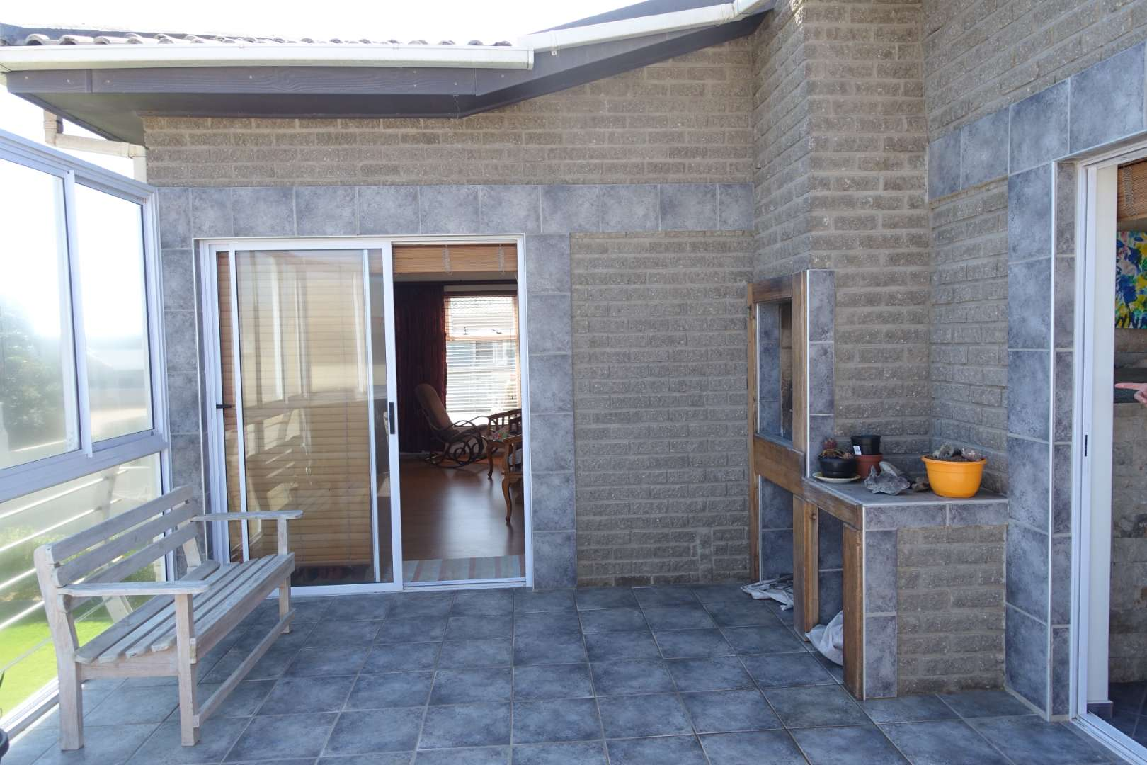 Sheltered balcony with access to lounge and kitchen area