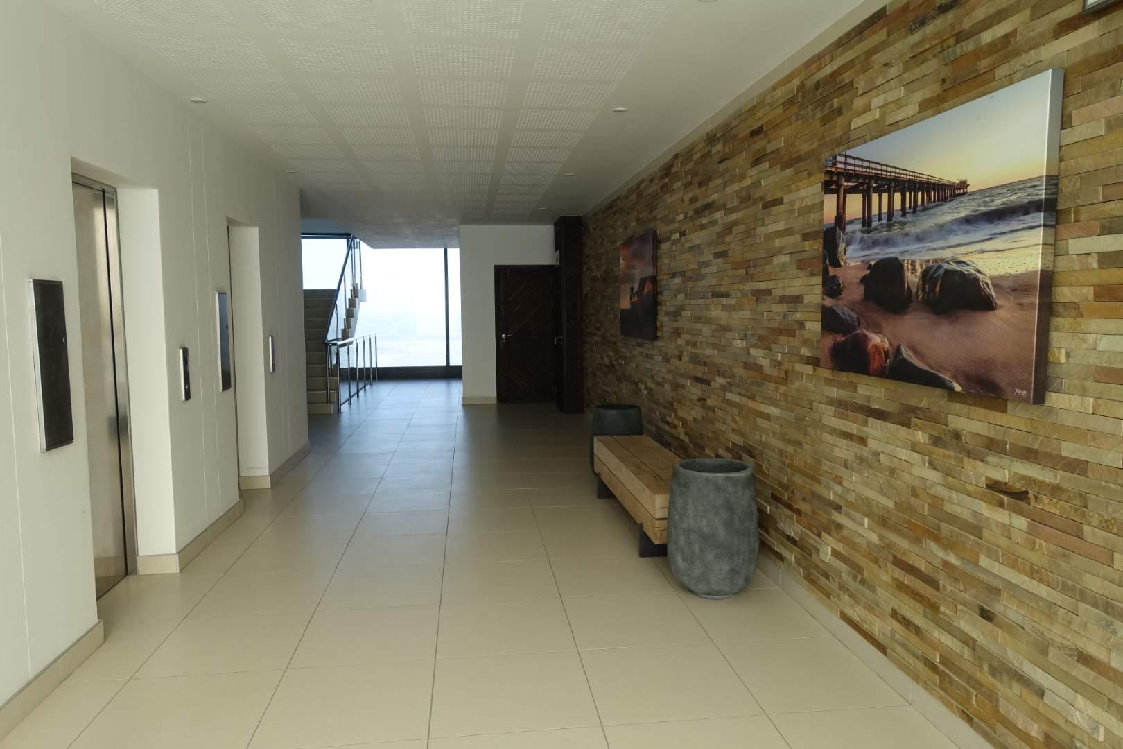 Passage with elevators
