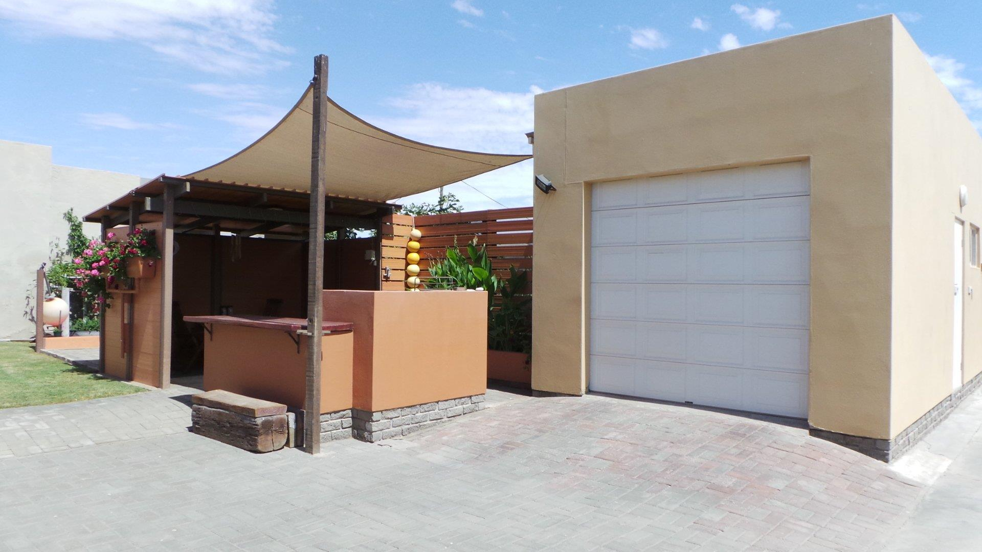 Outside entertainment area and tandem garage