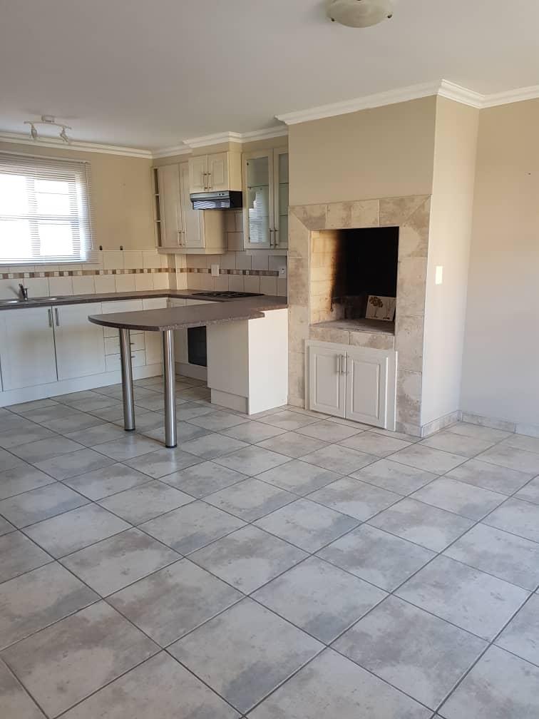 Kitchen - tv room area with indoor braai