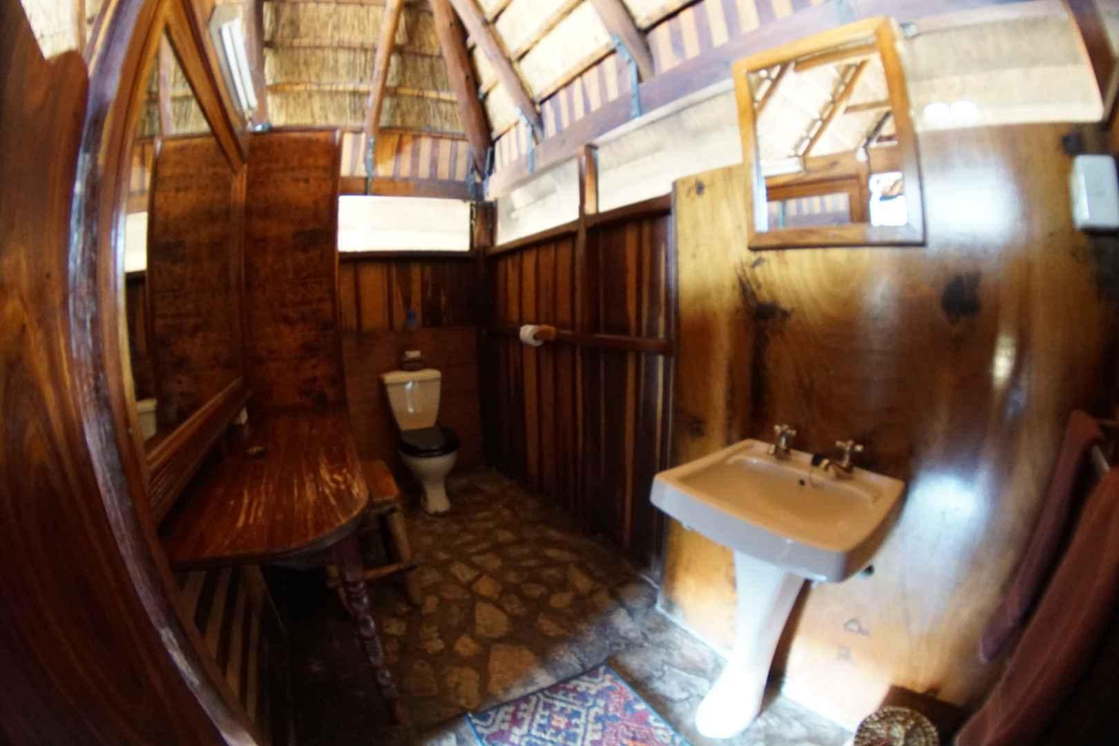 En-suite bathrooms made out of Kavango Rosewood