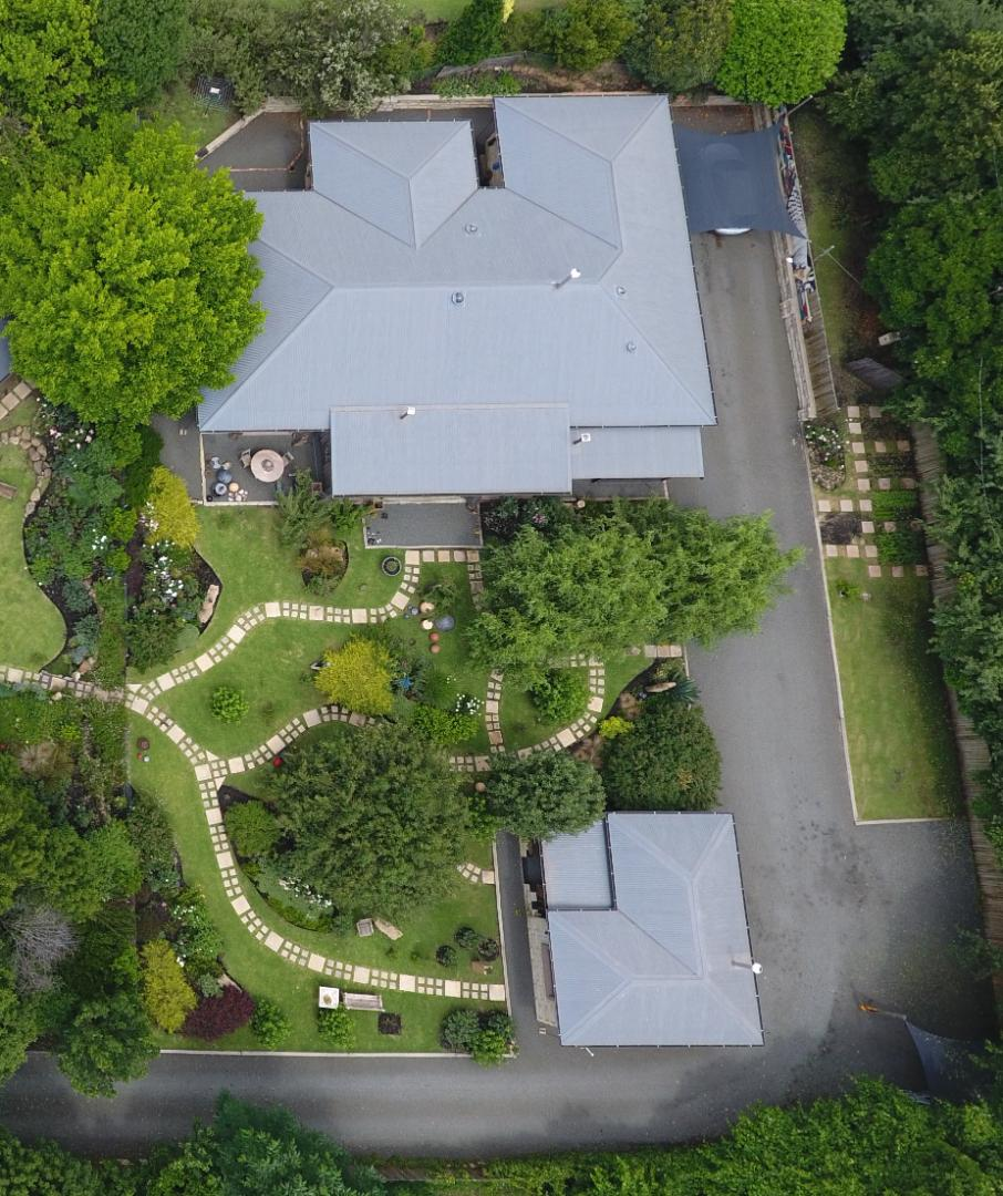 Aerial view of the property showing the main house at top and cottage bottom