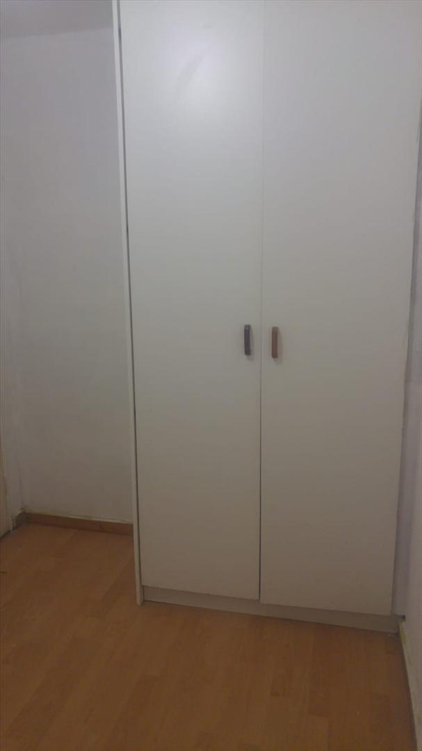 Bedroom 2 showing built-in cupboards