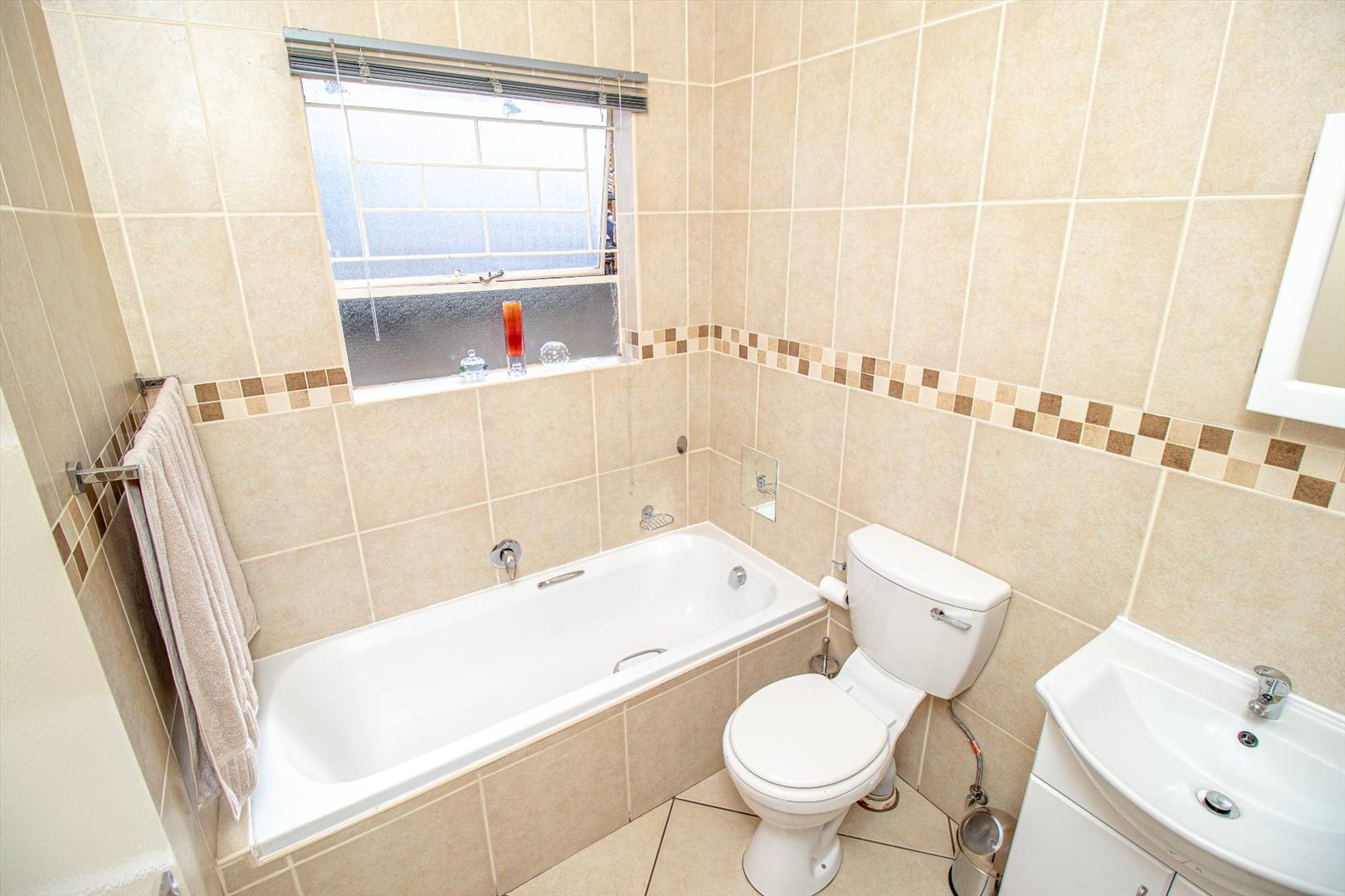 Spare bathroom with bath