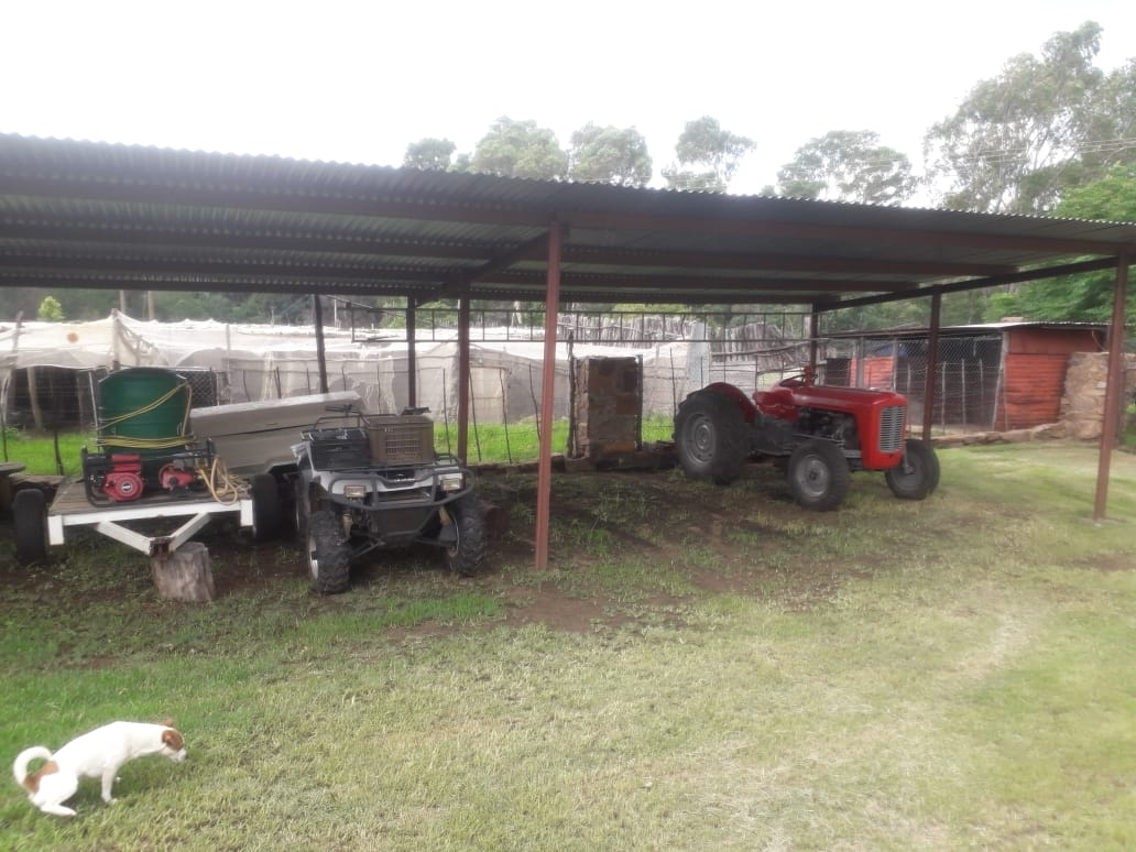 Carports for vehicles and farm machinery