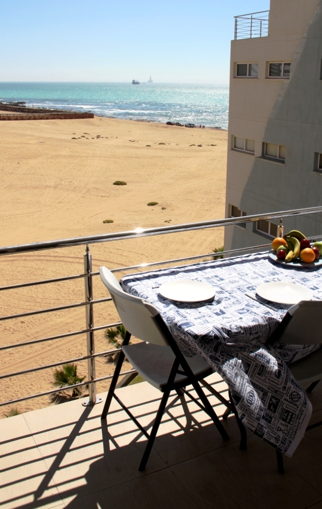 Spacious balcony with the most beautiful sea view and outdoor braai.