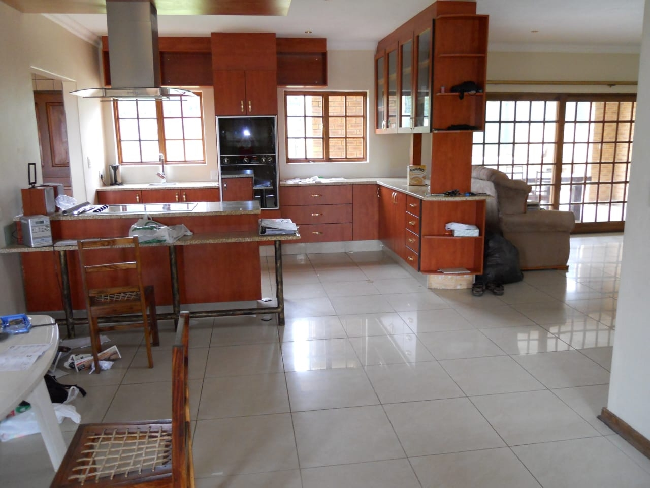 View of kitchen from dining area with lounge on right