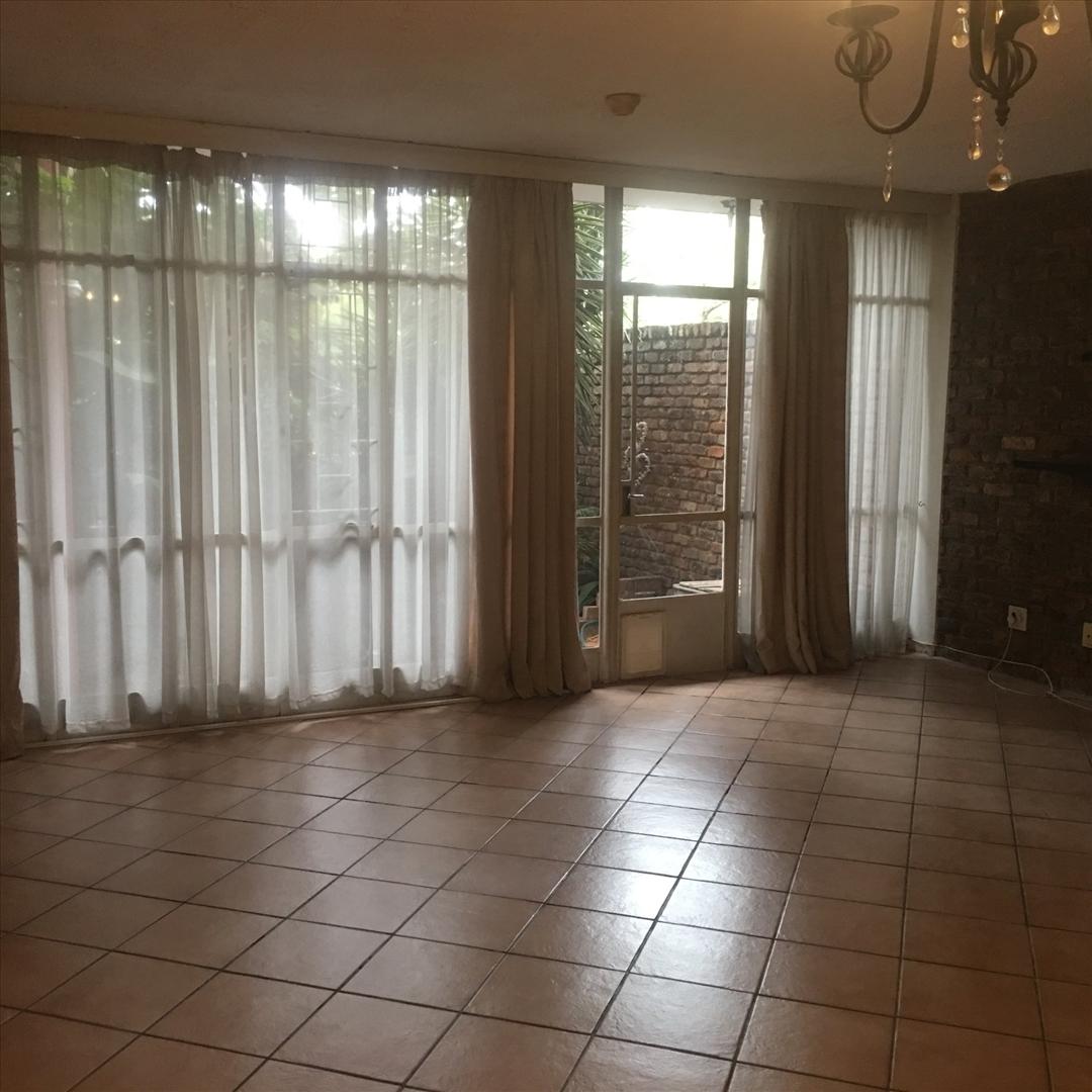 Living area with door to courtyard