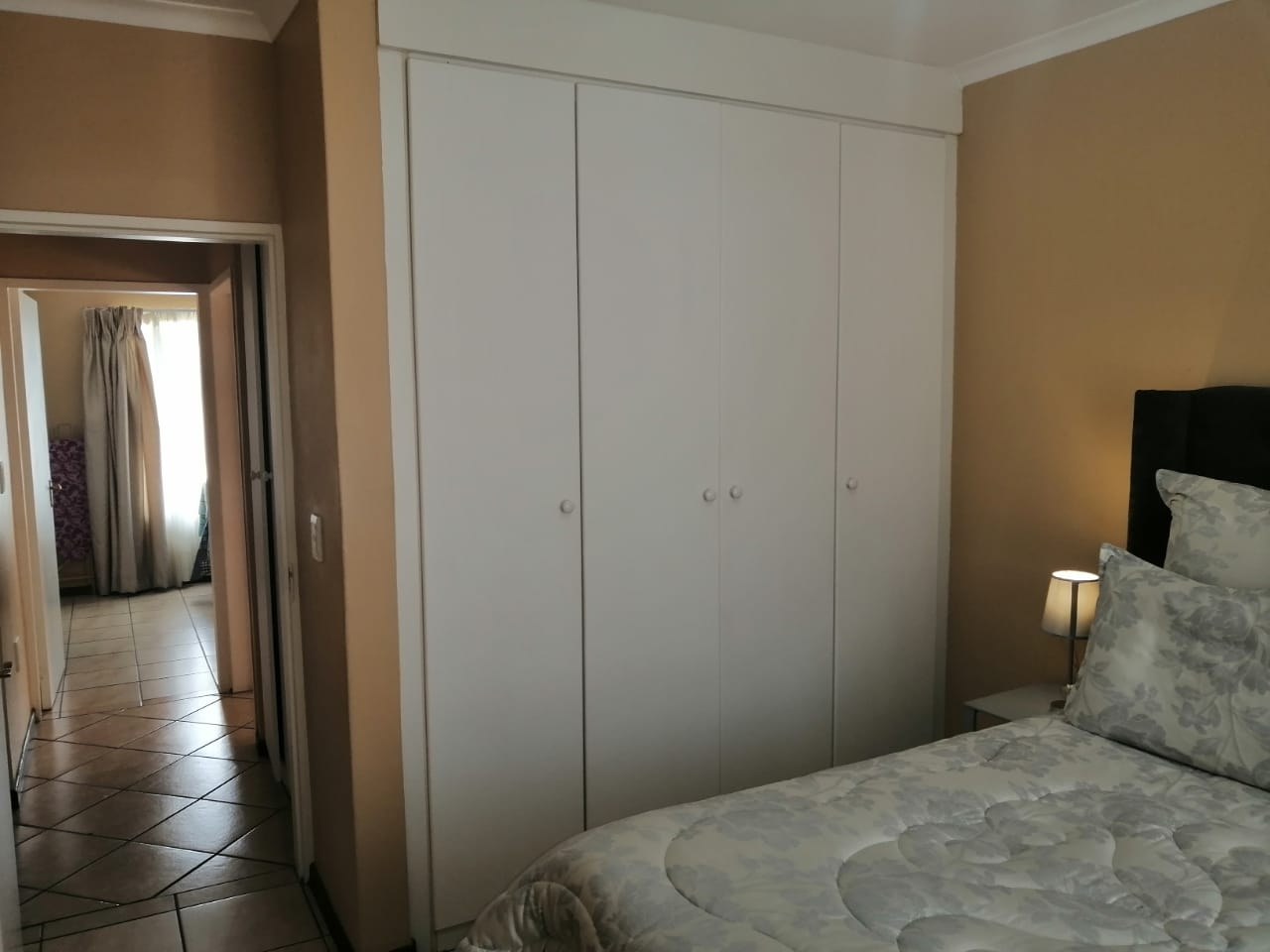 View inside main bedroom towards bedroom 2