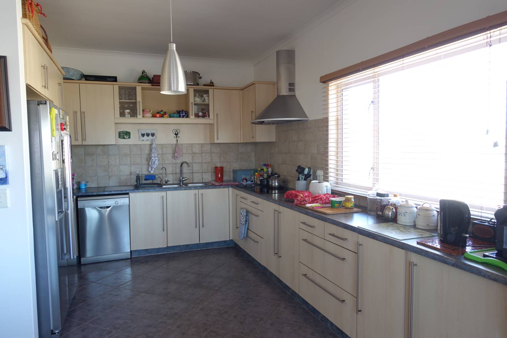 Kitchen open-plan with breakfast/dining area and BBQ