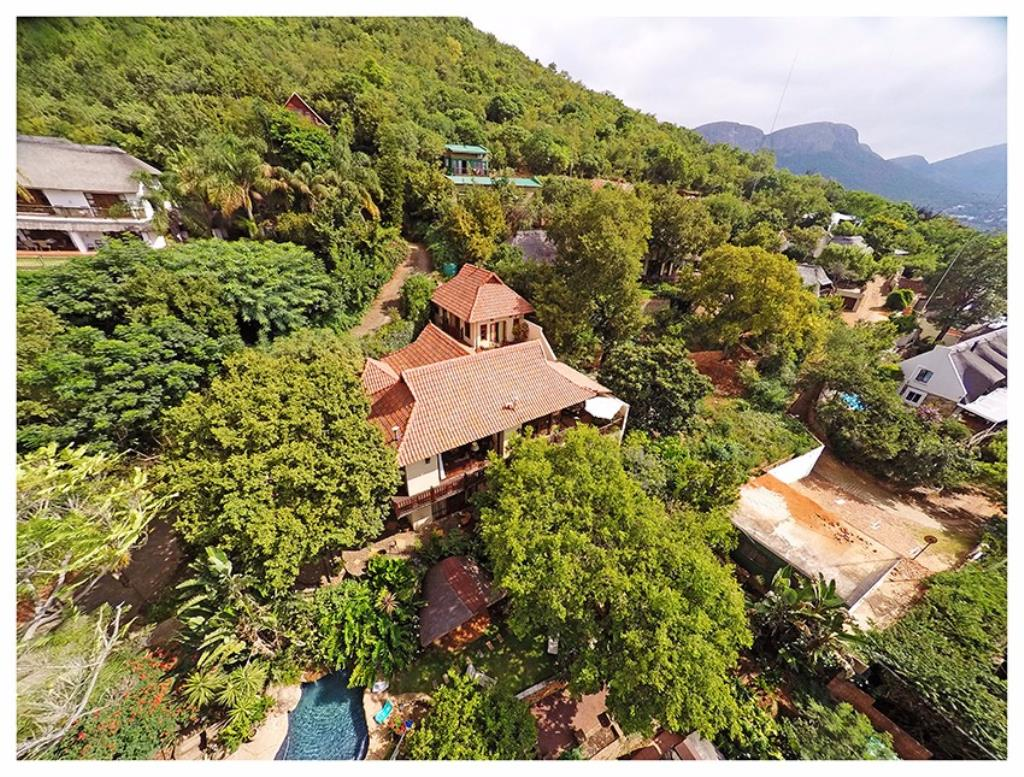Side aerial view of property