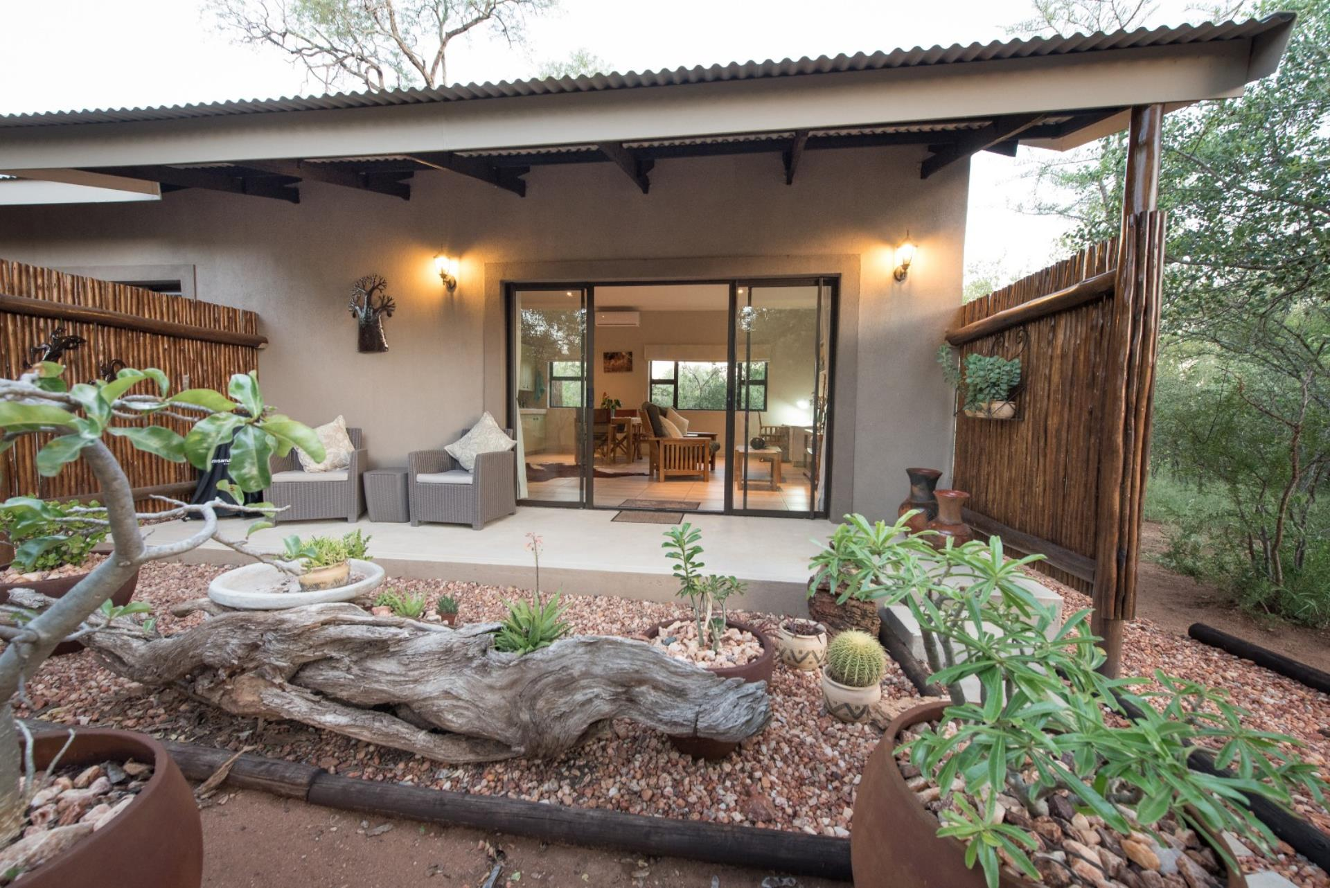 Guest house pending sale in hoedspruit wildlife estate for Houses for sale with guest house on property