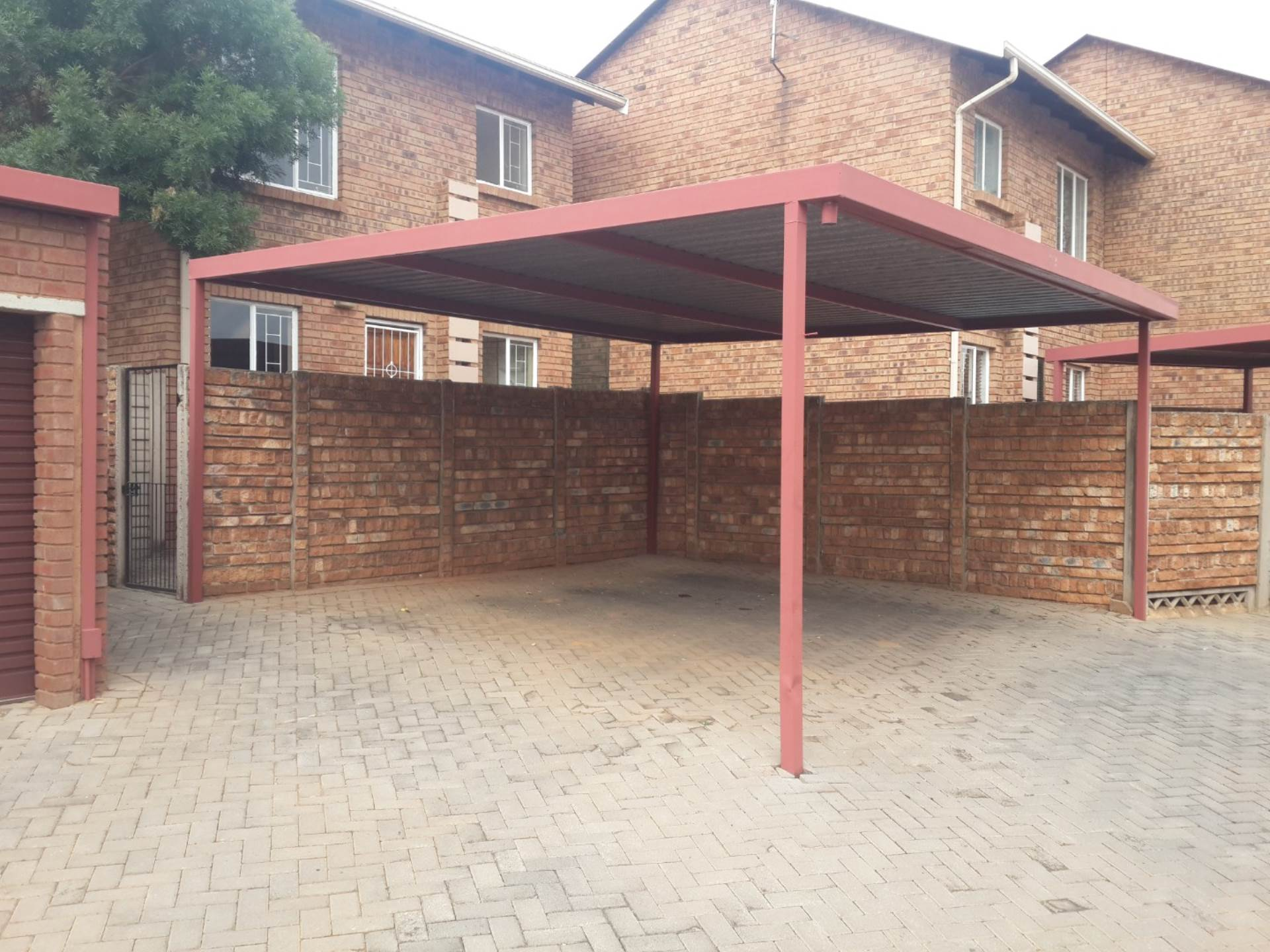 Double Carport At Entrance To Unit