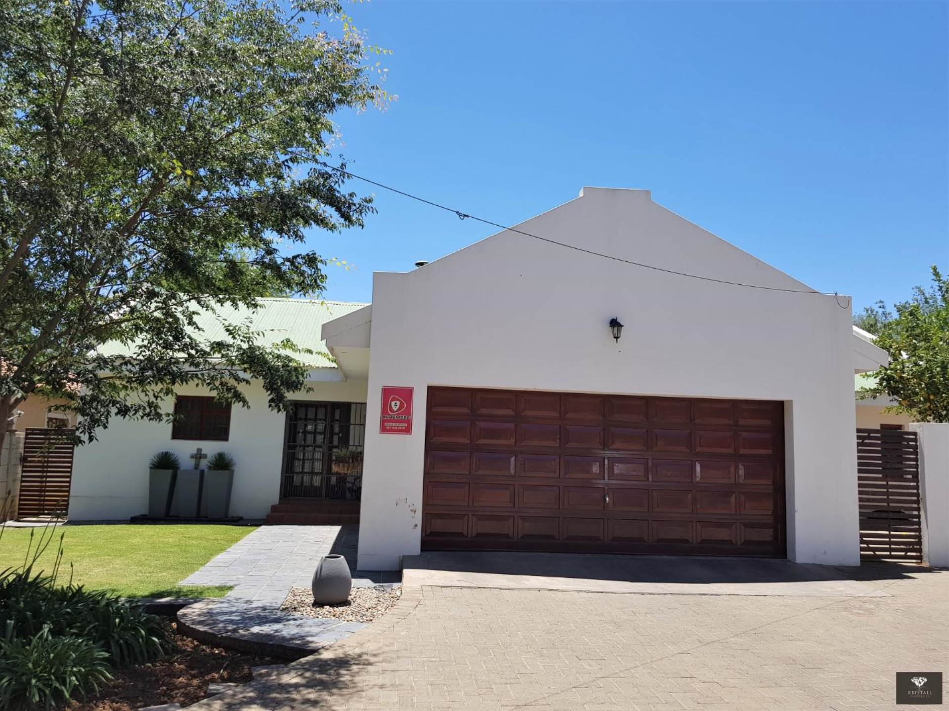 Double automated garages direct access into property