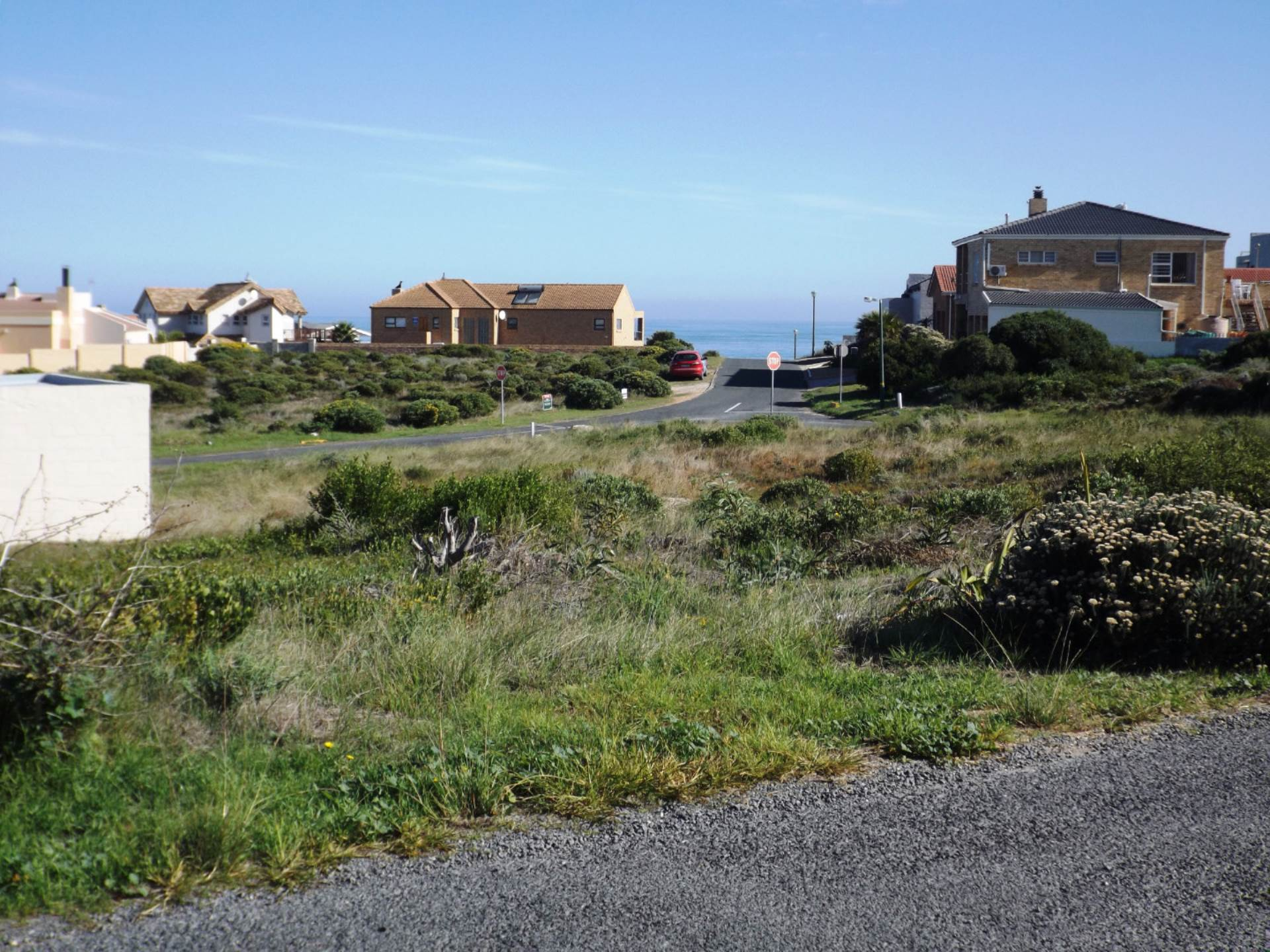 As from our Plot; another vacant Plot across Street. Sea at back.