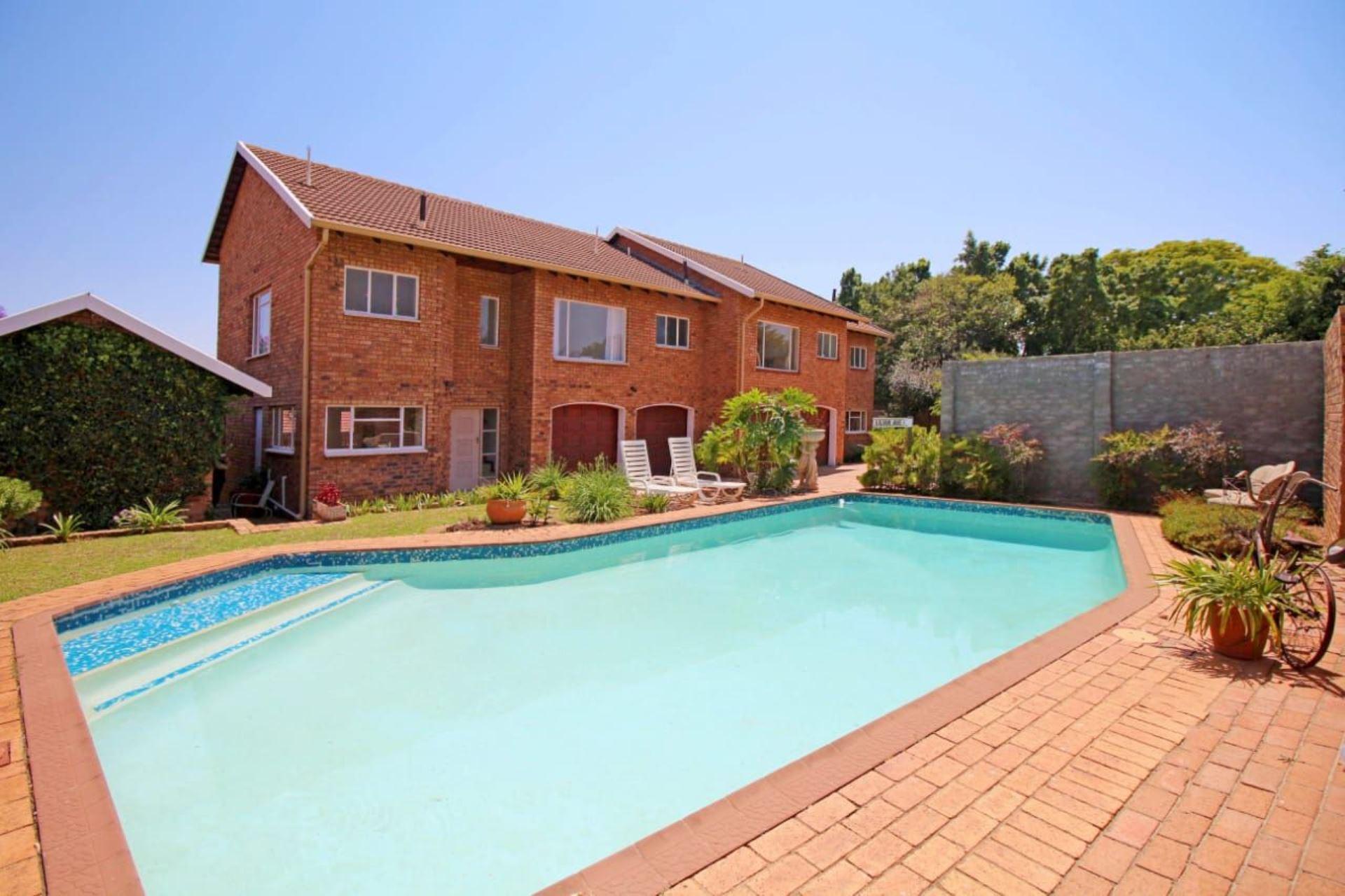 Front Garden & Pool Area