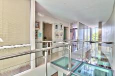Glass floor allows, triple volume height and glass walls