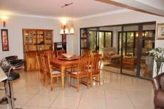 Open-plan dining area with sliding doors to braai room