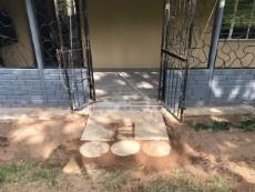 Entrance to front of house through patio