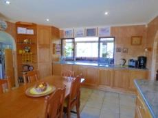 Kitchen opening onto entertainment area / family room