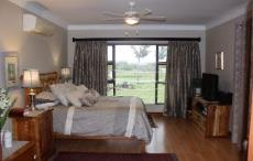 Main bedroom with sliding doors to enclosed patio