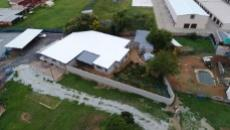 Aerial view of house at the back of the property